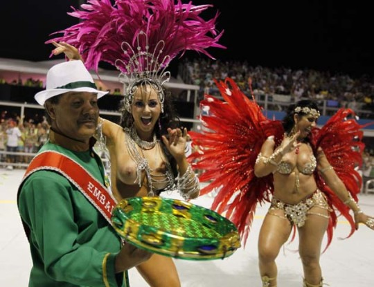 Models parade for Camisa Verde e Branco Samba School during carnival in Sao Paulo