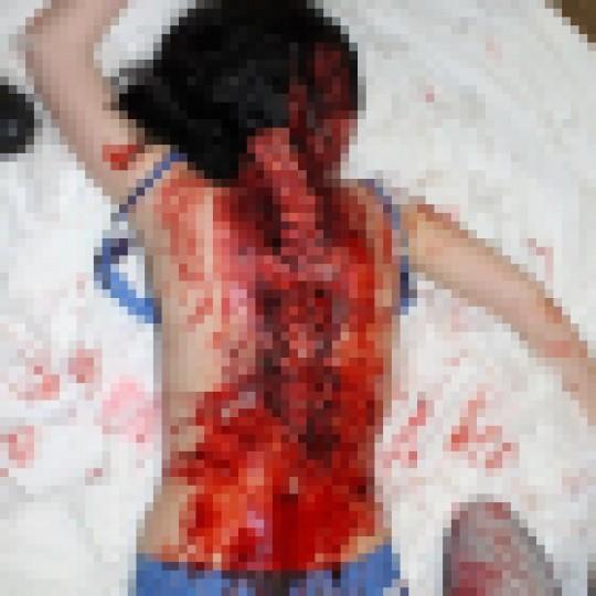 【閲覧注意】レイプされた後ポアされた女性の画像貼ってく。脚無いのとかもう理解不能・・(画像22枚)・16枚目